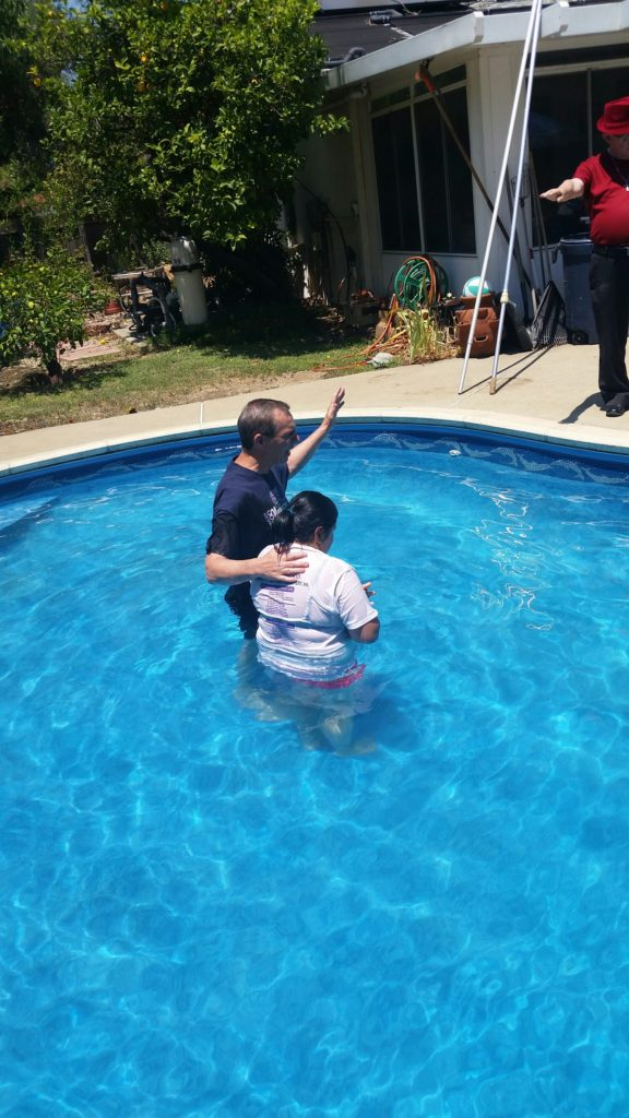 One of our women being baptized